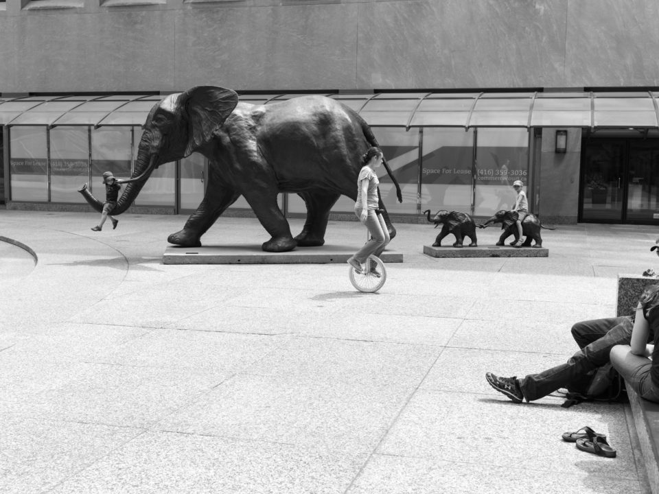 Children Playing On Elephant Sculpture