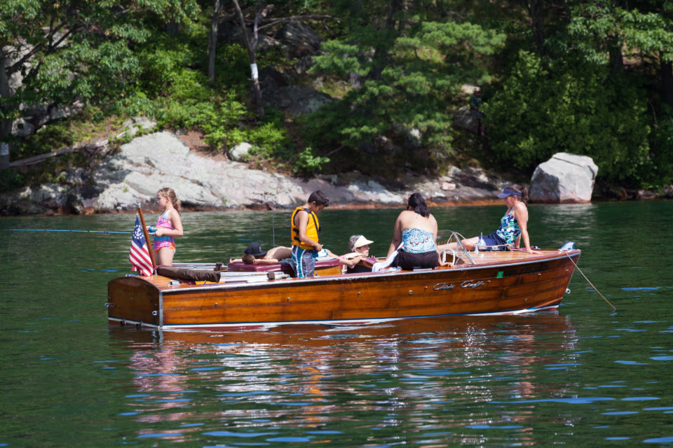Family On A Wooden Boat