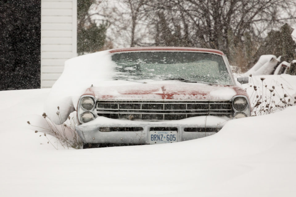 Old Car In The Snow