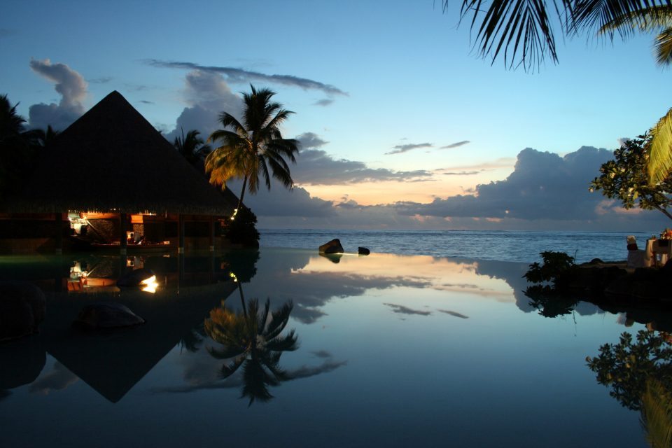 disappearing edge infinity pool at sunset with pool bar tahiti