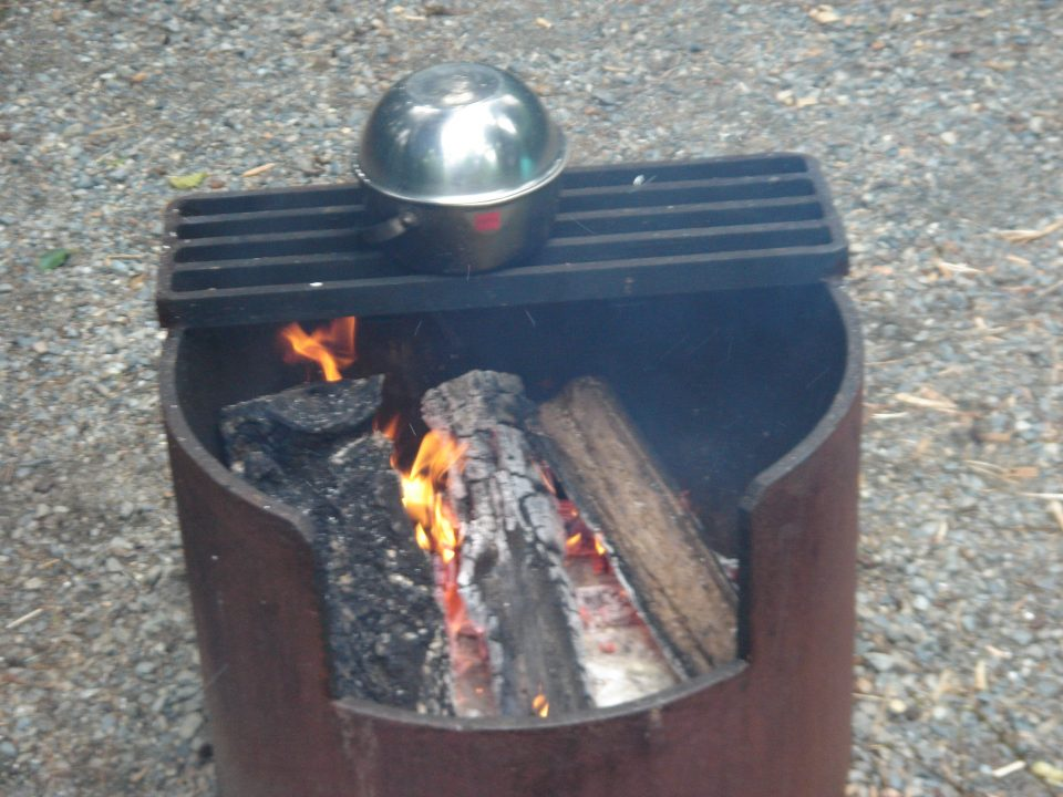 cooking in the open fire