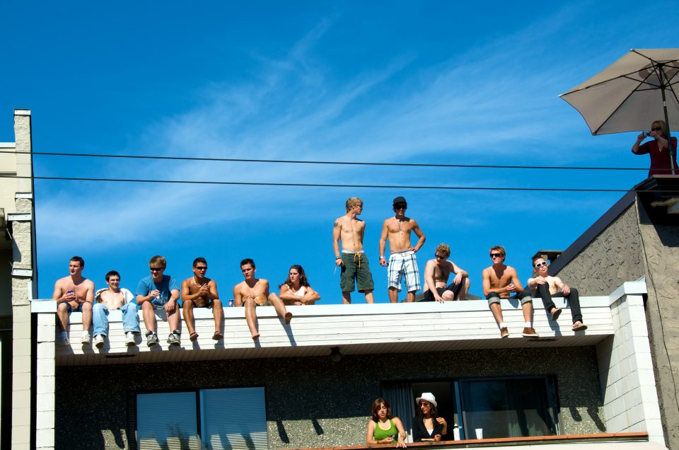 Spectators On Top Of Building