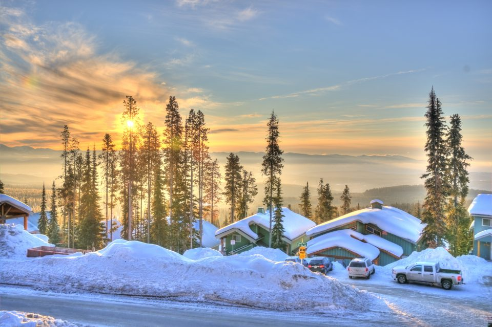 big white chalet at sunset