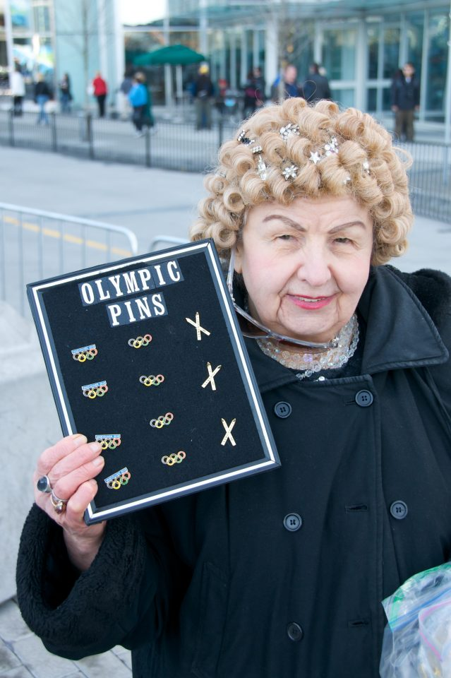 Old Lady Selling Olympic Pins