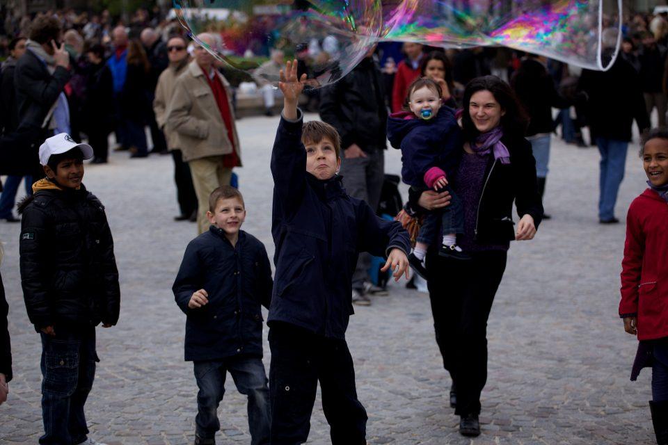 Boy Pops Bubble at the Cathédrale Notre Dame