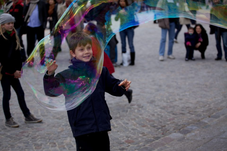 Boy Pops Bubble at the Cathédrale Notre Dame