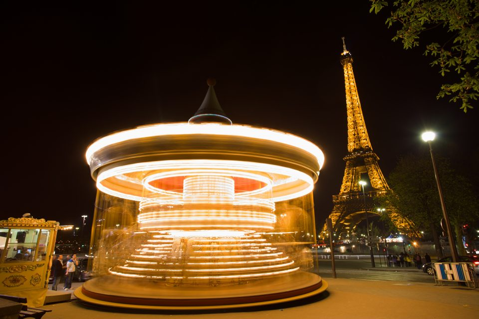Spinning Carousel and Eiffel Tower at Night