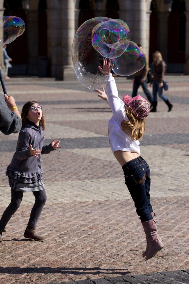 Kids Chasing Bubbles