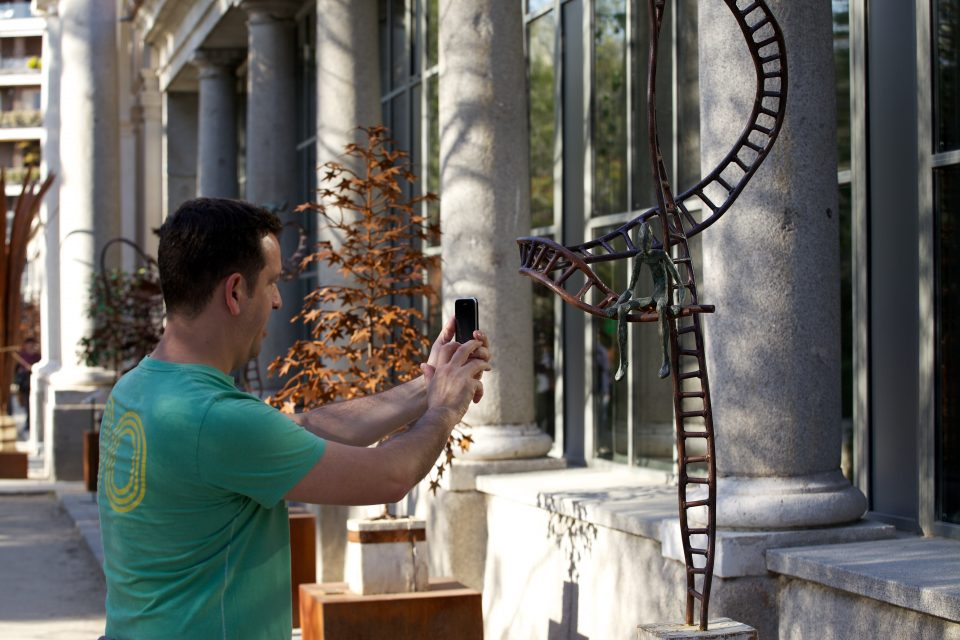 Man Photographs Sculpture at Royal Botanical Garden, Madrid