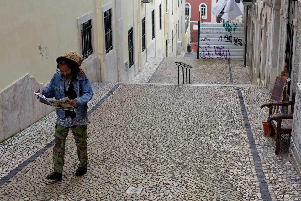 Man Walking and Reading Newspaper