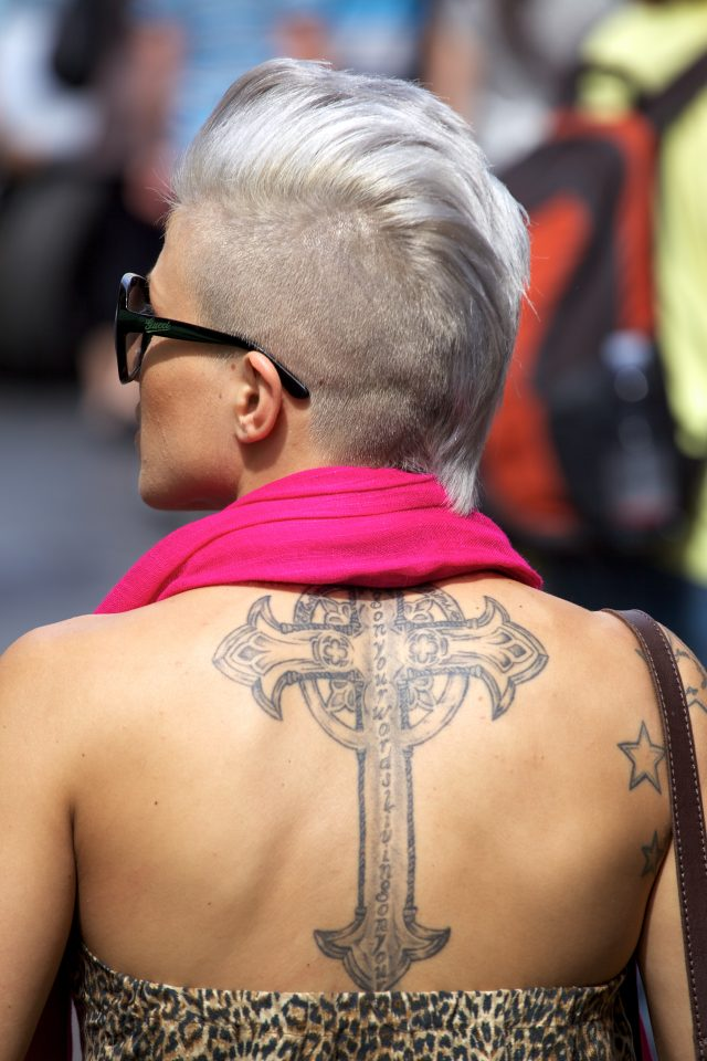 Woman With Large Cross Tattoo On Her Back in Rome
