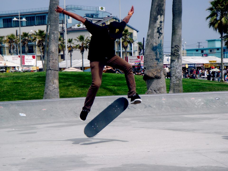 Skateboarder Kickflip Venice Beach California