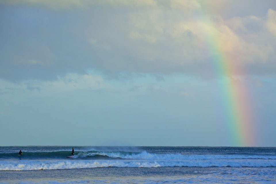 Surfers And Rainbow