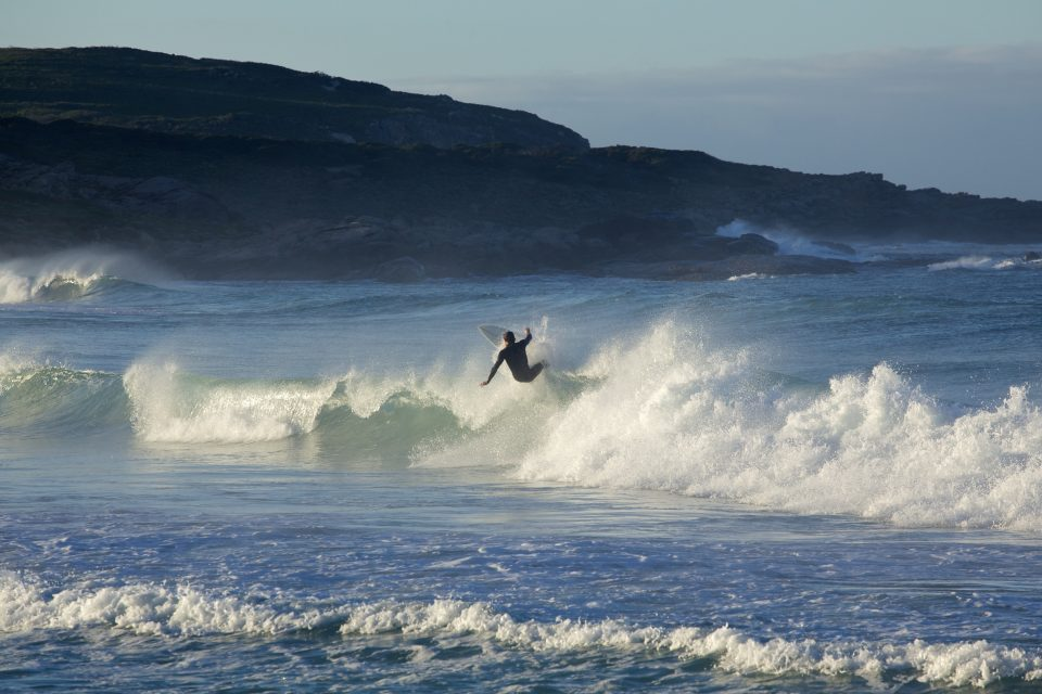 Surfer Carving Up A Wave