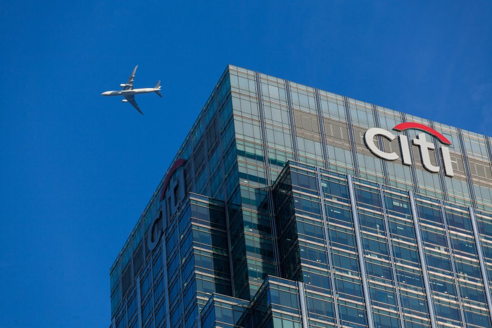 Airplane Flying Over Citibank Canary Wharf London