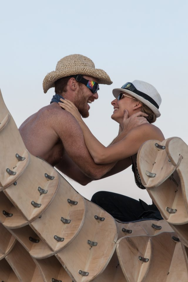 Happy Burners Embrace On The Hands Sculpture Burning Man 2013