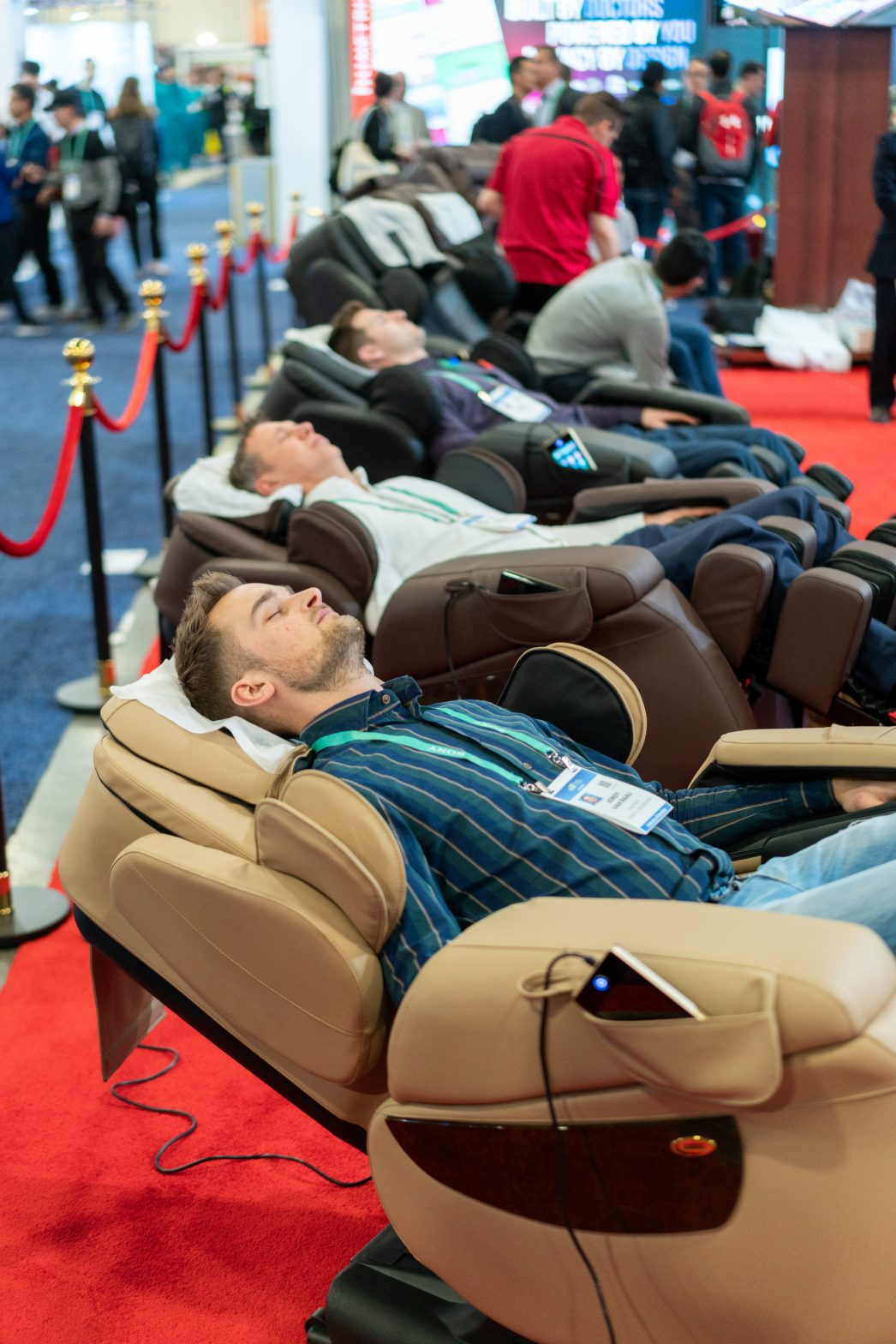 people sleeping in massage chairs